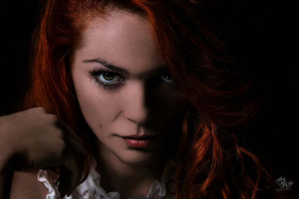 """Redhead out of the dark"""
